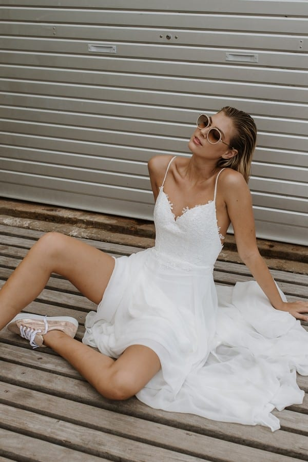 02_rosemary_wedding_dress_sitting_down_side_view.jpg.600x900